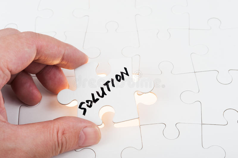 Puzzle with solution word stock photo