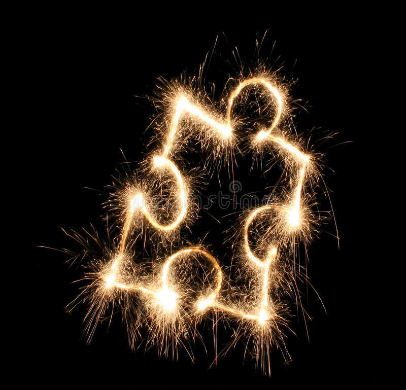 Puzzle sparkler royalty free stock photography
