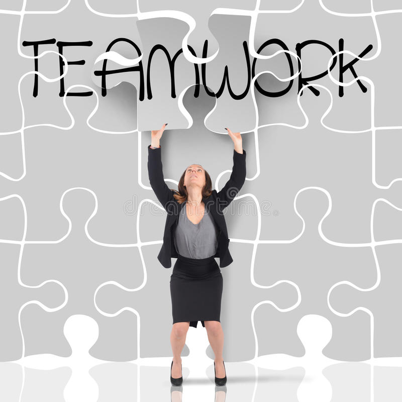 Puzzle teamwork stock photography