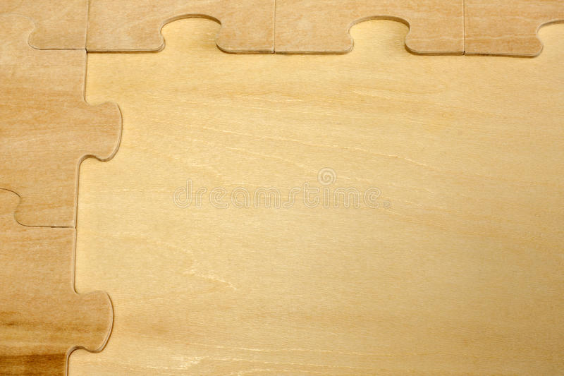 Puzzle on wooden boards abstract background stock photos