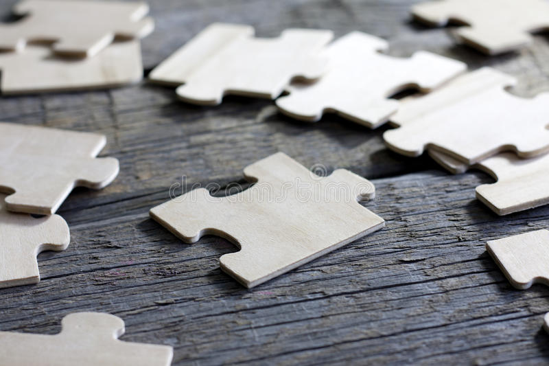 Puzzle on wooden boards team business concept royalty free stock image