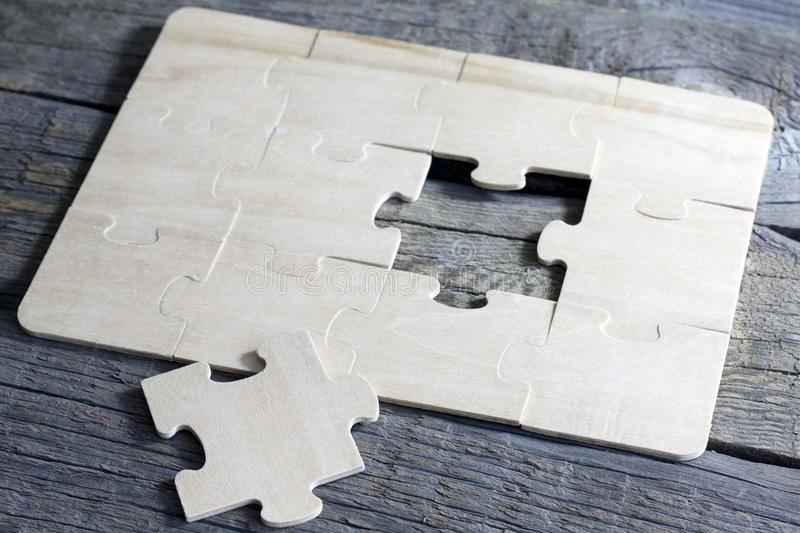Puzzle on wooden boards team business concept stock photography