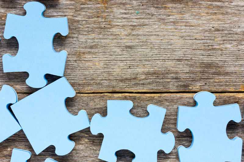 Puzzle on wooden boards royalty free stock images
