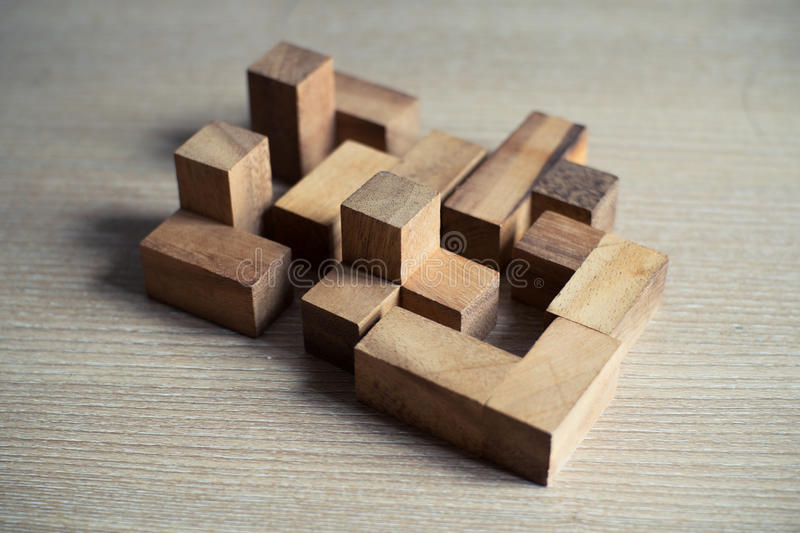Puzzle wooden game. On wood table stock images
