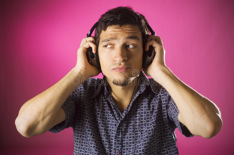 Puzzled boy listening music royalty free stock photography