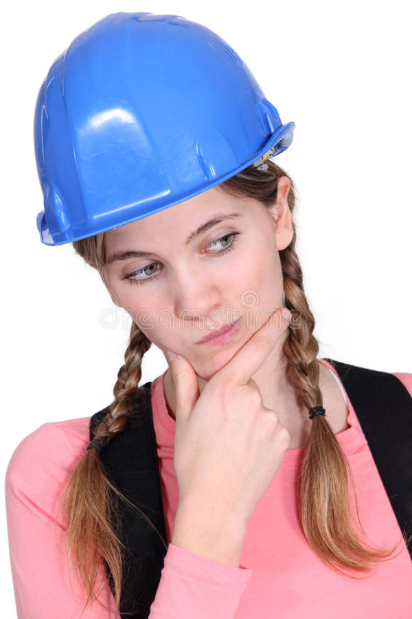 Puzzled female apprentice royalty free stock image