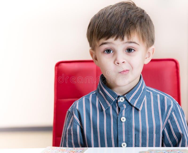 Puzzled little boy royalty free stock photos