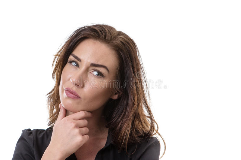 Puzzled pretty woman. Portrait of a puzzled woman looking at the camera royalty free stock image