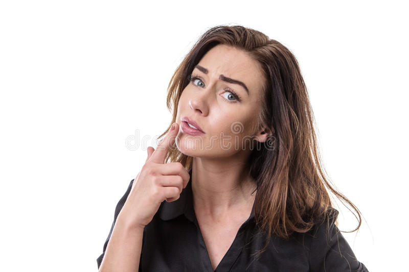 Puzzled pretty woman. Portrait of a puzzled woman looking at the camera royalty free stock photos