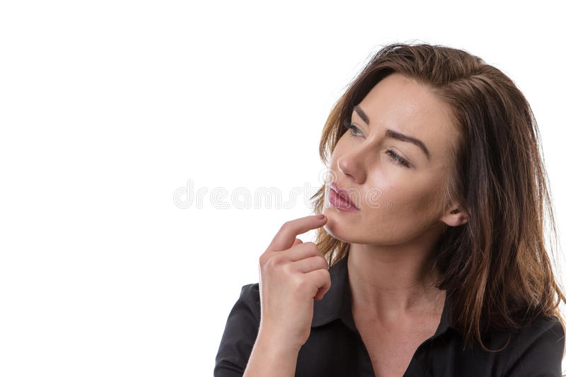Puzzled pretty woman. Portrait of a puzzled woman looking at the camera stock photo