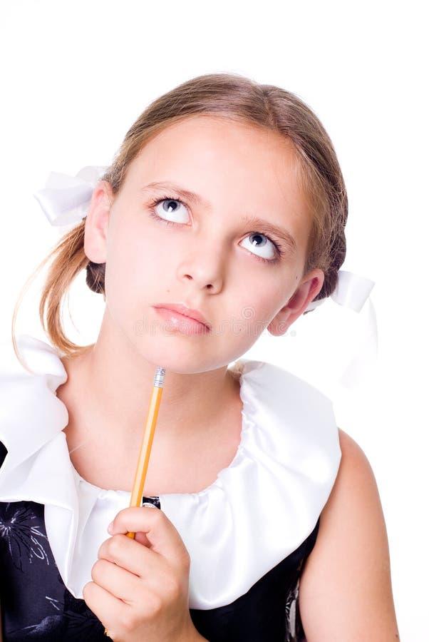 Download Puzzled schoolgirl stock photo. Image of childhood, background - 6134714