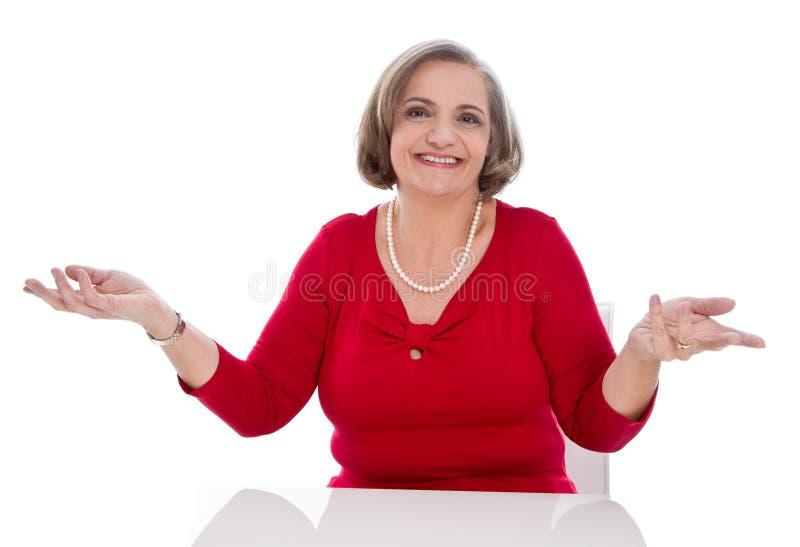 Puzzled senior woman - elder woman isolated on white background royalty free stock photo