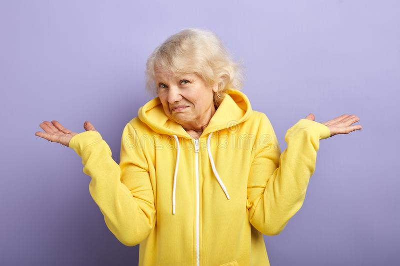 Puzzled senior woman with a quizzical and confused expression stock images