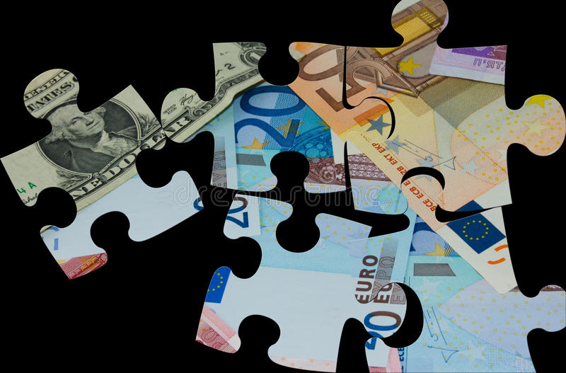 Puzzles. Jigsaw puzzles superimposed with world major currencies royalty free stock image