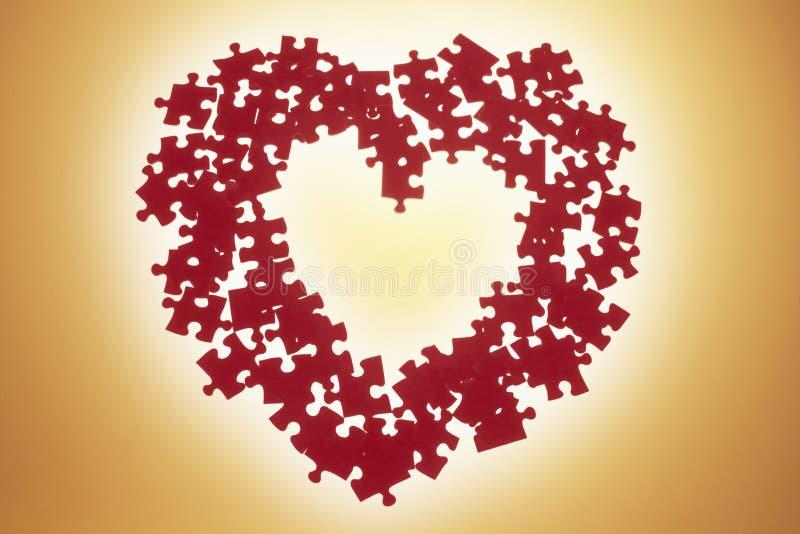 Puzzles dans la forme de coeur image stock