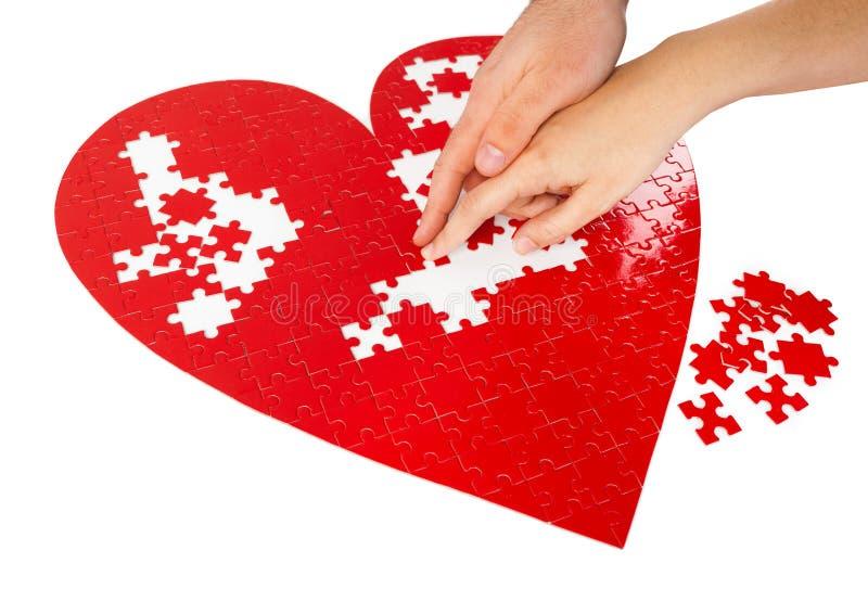 Puzzles rouges de coeur photos libres de droits
