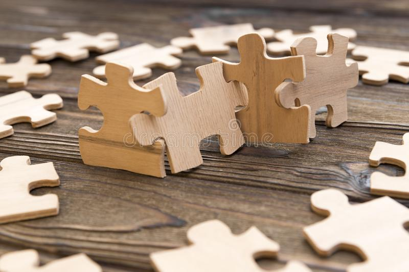Puzzles of wood on the background stock image