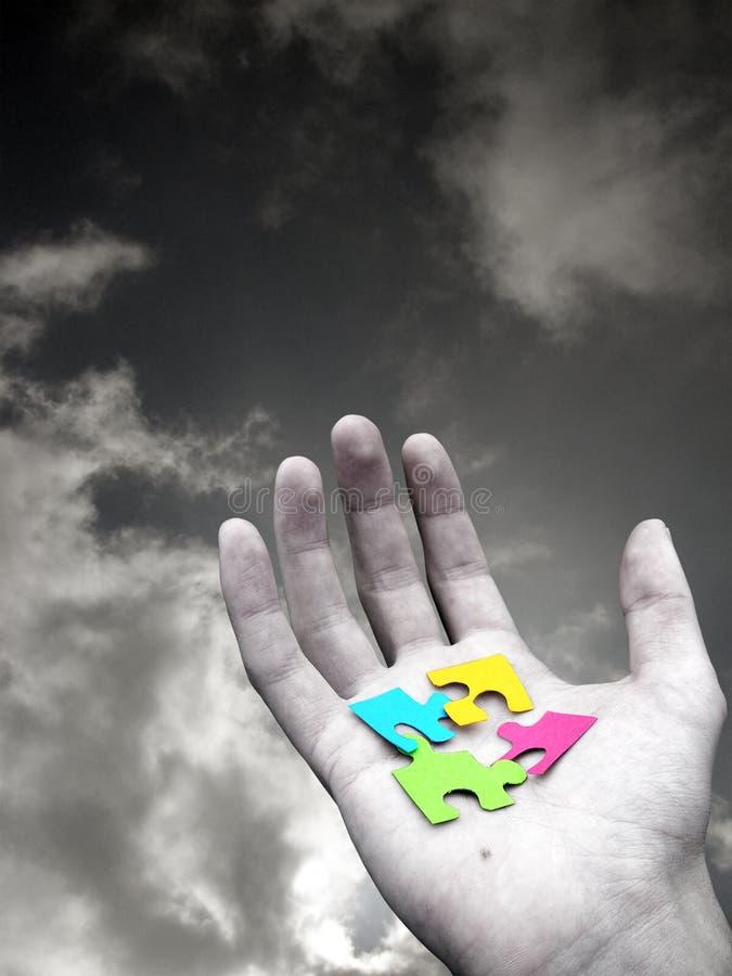 Puzzlespiel in der Hand