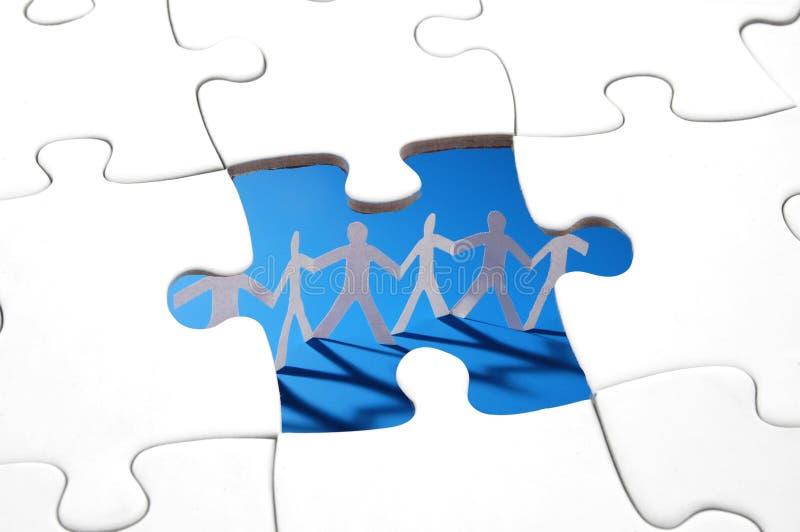 Puzzlespiel und Teamwork lizenzfreies stockbild