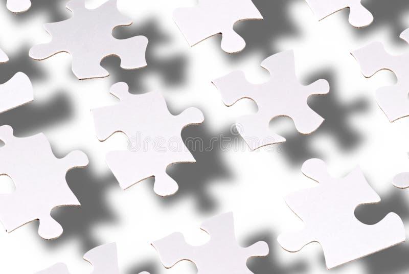 Puzzlespielstückschwimmen stockfoto