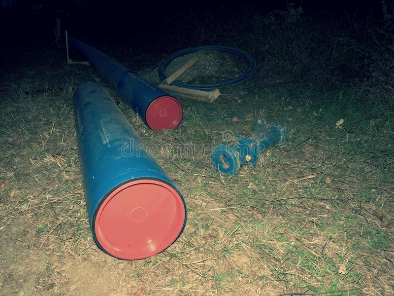 PVC pipes for potable water pipelines. Renewal works continue within night warehouse vivid vibrant tube texture technology system stack solid site sewerage royalty free stock images