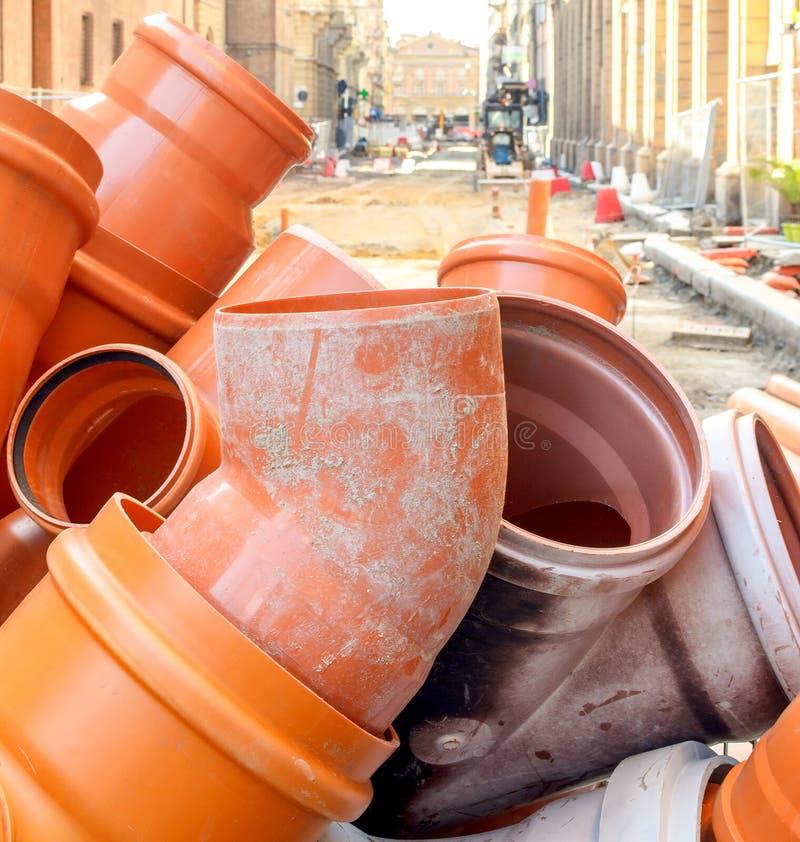 PVC sewer pipe joint plastic pipework orange road work surfacing stock image