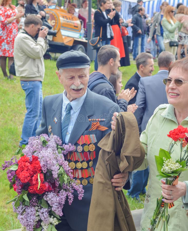 PYATIGORSK, RUSSIA - MAY 09, 2017: Veterans with medals. The Victory Day celebration. PYATIGORSK, RUSSIA - MAY 09, 2017: Veterans with medals and flowers. The stock photography