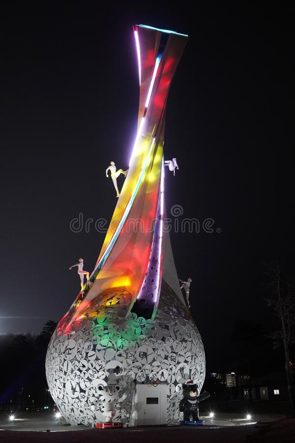 PyeongChang Brightens the World sculpture in front of Holiday Inn Resort Alpensia. PYEONGCHANG, SOUTH KOREA - FEBRUARY 18, 2018: PyeongChang Brightens the World royalty free stock photography