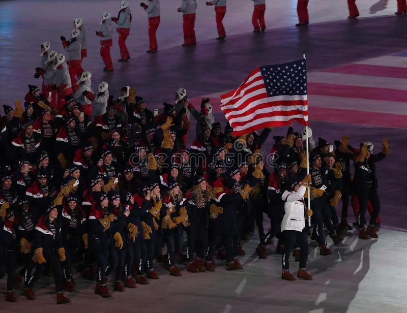 Olympic champion Erin Hamlin carrying the United States flag leading the team USA the PyeongChang 2018 Olympics opening ceremony. PYEONGCHANG, SOUTH KOREA royalty free stock photo