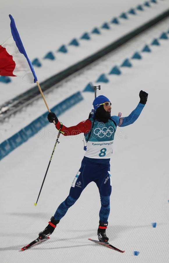 Olympic champion Martin Fourcade of France celebrates victory in biathlon men`s 12.5km pursuit at the 2018 Winter Olympics stock images