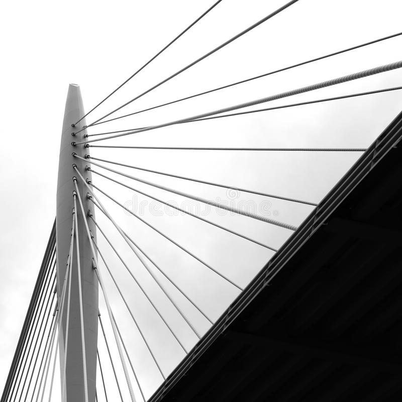 Pylon of the bridge, Utrecht. Close up to the bridge in Utrecht, Netherlands. Suspension cables connected to the pylon. Picture desaturated to bw, abstract look stock images