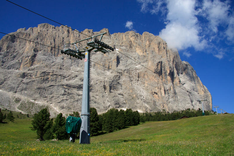 Pylon of the cable car and Sassolungo royalty free stock images