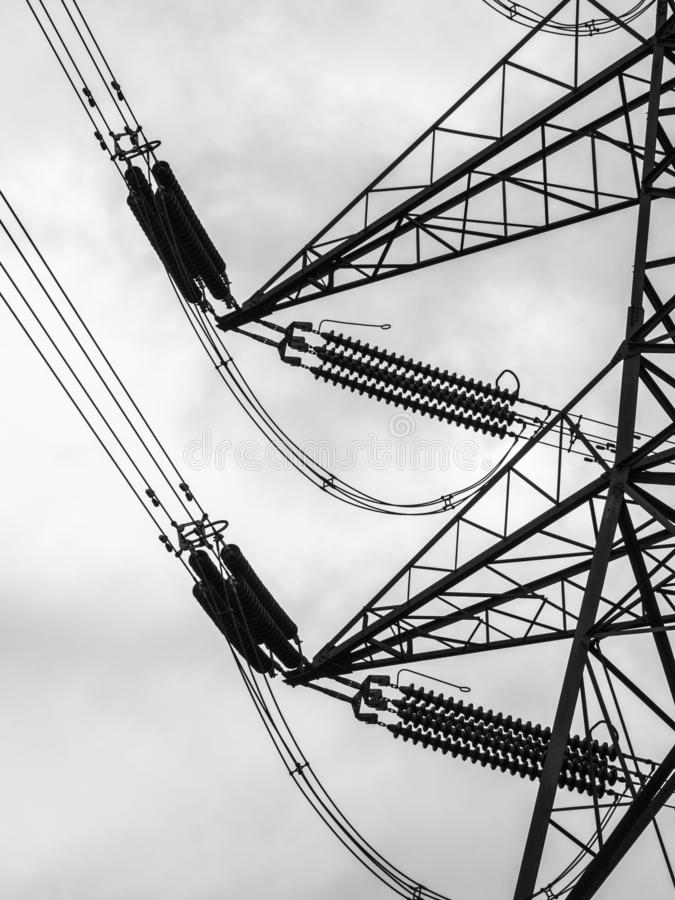 Electricity Pylon Transmission Tower close-up four circuit. A black and white close-up of a four-circuit lattice transmission tower or electricity pylon, near stock photography