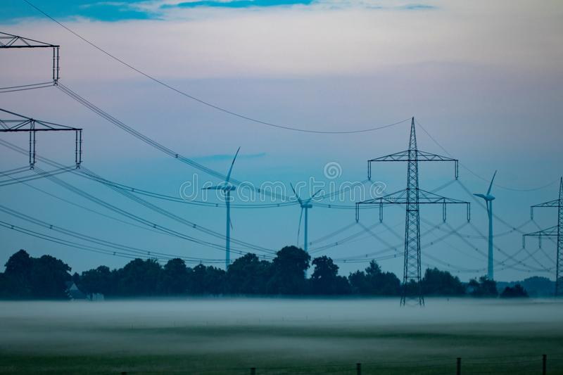 Pylon and transmission power line in sunset royalty free stock photography