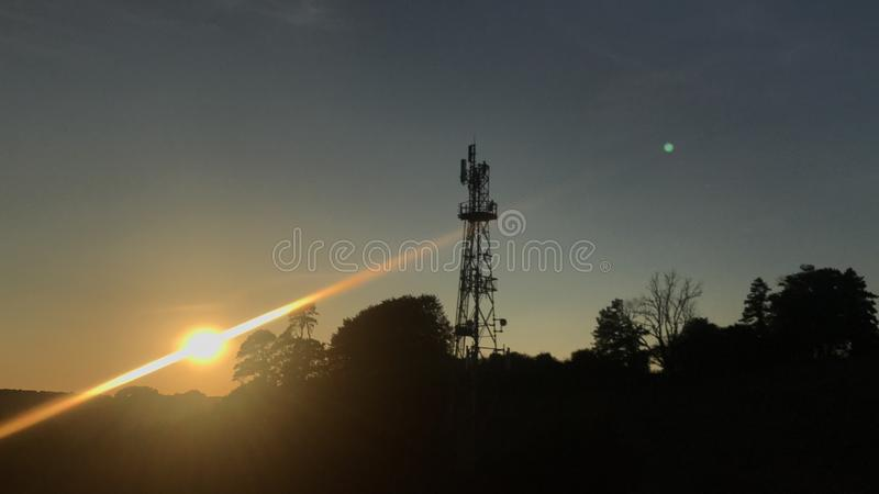 Pylon zonsondergang stock afbeeldingen
