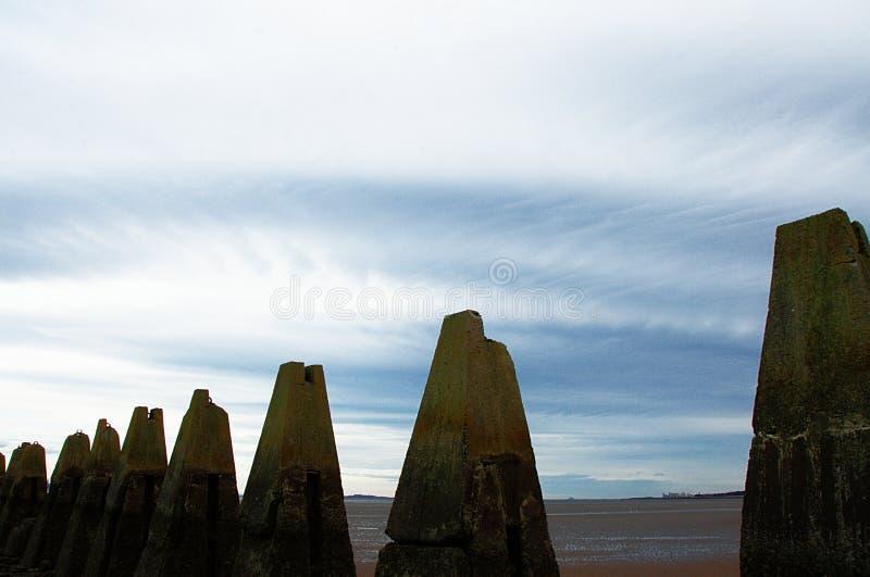 Pylons leading to Cramond island royalty free stock photography