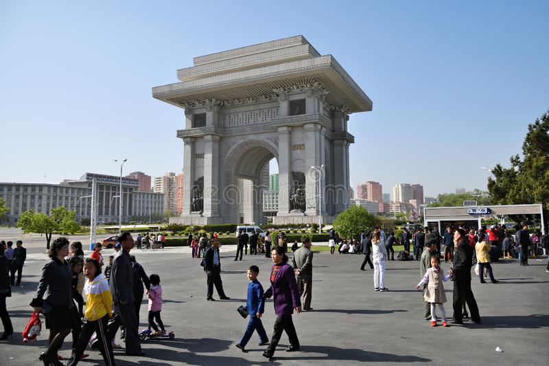 Pyongyang, North Korea. Pyongyang, Arch of Triumph. Pyongyang, North Korea - May 1, 2019: People in the square next to Arch of Triumph. A monument built in royalty free stock image