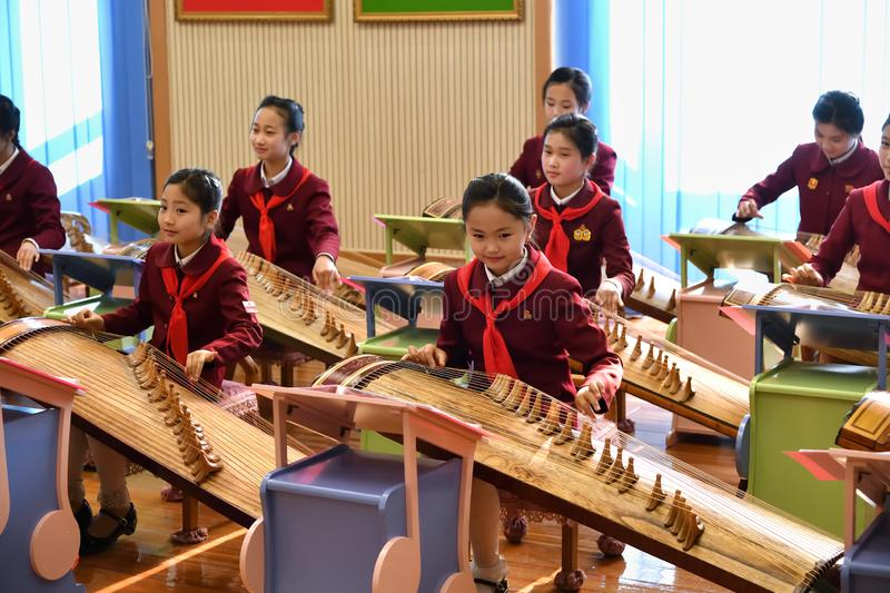 Pyongyang, North Korea. Girls in music school. Pyongyang, North Korea -  May 2, 2019: The Mangyongdae School Children`s Palace. Extracurricular educational royalty free stock photos