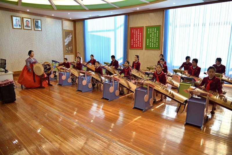 Pyongyang, North Korea. Girls in music school. Pyongyang, North Korea -  May 2, 2019: The Mangyongdae School Children`s Palace. Extracurricular educational royalty free stock photo