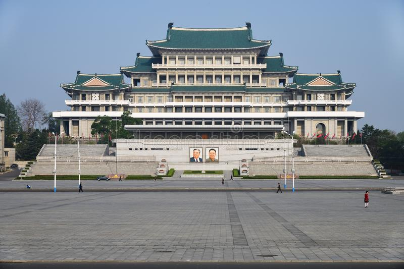 Pyongyang, North-Korea. Kim Il Sung square. Pyongyang, North-Korea - May 1, 2019: The central square of Kim Il Sung. Great People`s Study House with of portraits stock photos