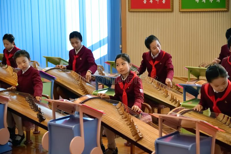 Pyongyang, North Korea. Girls in music school. Pyongyang, North Korea -  May 2, 2019: The Mangyongdae School Children`s Palace. Extracurricular educational royalty free stock image