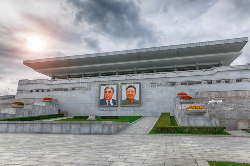 PYONGYANG,NORTH KOREA-OCTOBER 12,2017: Tribune with portraits of. The leaders in the main square of the city royalty free stock images