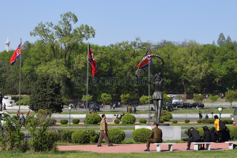 Pyongyang, North Korea. People. Pyongyang, North Korea - May 1, 2019: Local people resting in the square in front of the Kim Il Sung Stadium royalty free stock photos