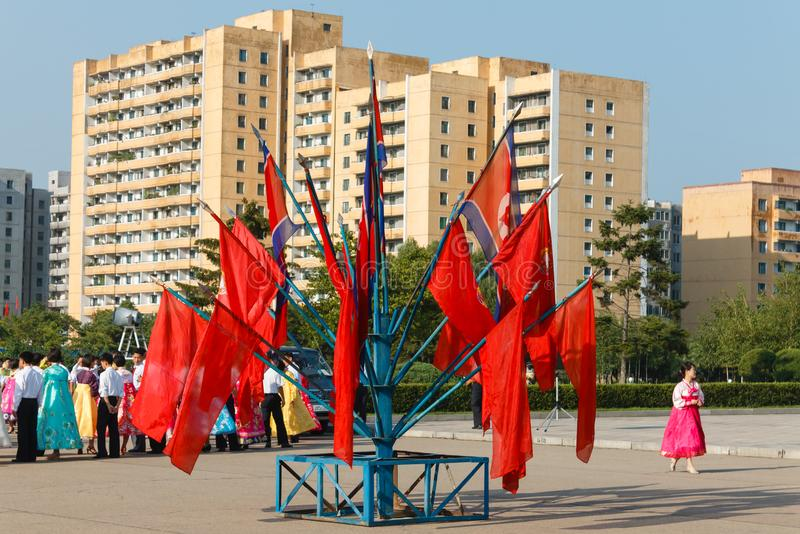 Pyongyang, North Korea. July 27, 2014: Red flags on the square in the city of Pyongyang in honor of the victory in the Fatherland Liberation War of the Korean stock images