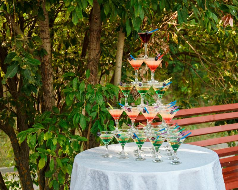 A pyramid of alcoholic cocktails at a wedding celebration royalty free stock photography