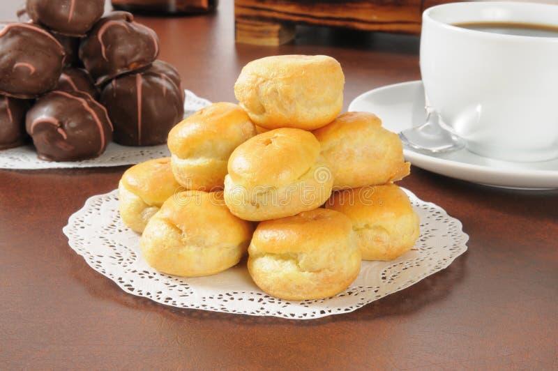 Bite sized cream puffs. A pyramid of bite sized cream puffs stock photos