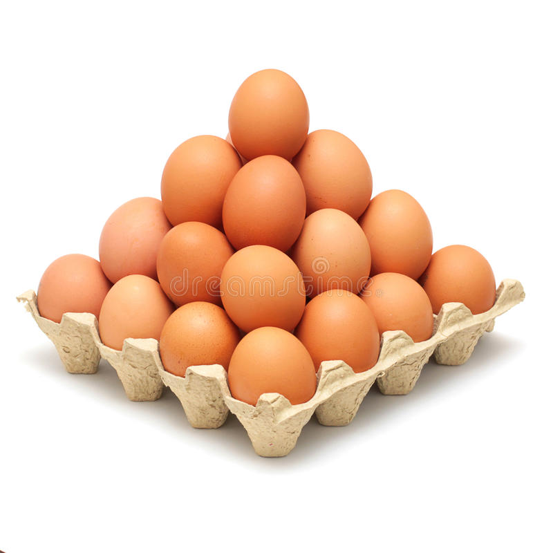 Pyramid of brown eggs. Isolated on white background stock photo