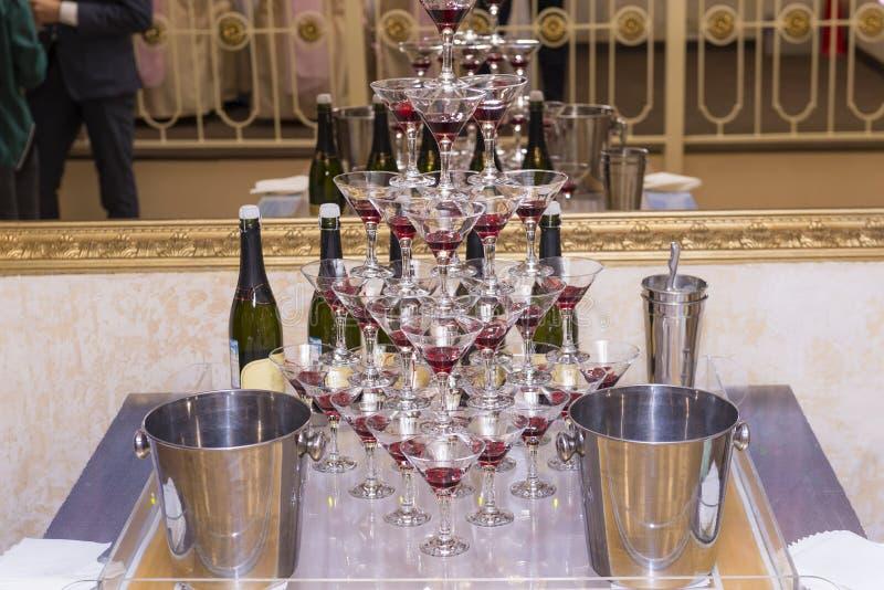 Pyramid of champagne glasses, glass glasses, bottles, festive se stock photo
