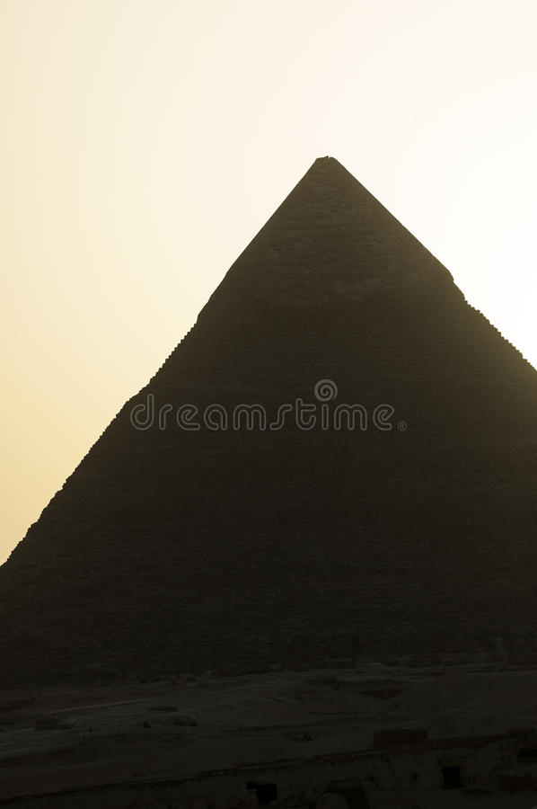 Pyramid of Chefren (backlit). Silhouette (sunset) of Great Pyramid of Giza, Egypt royalty free stock images