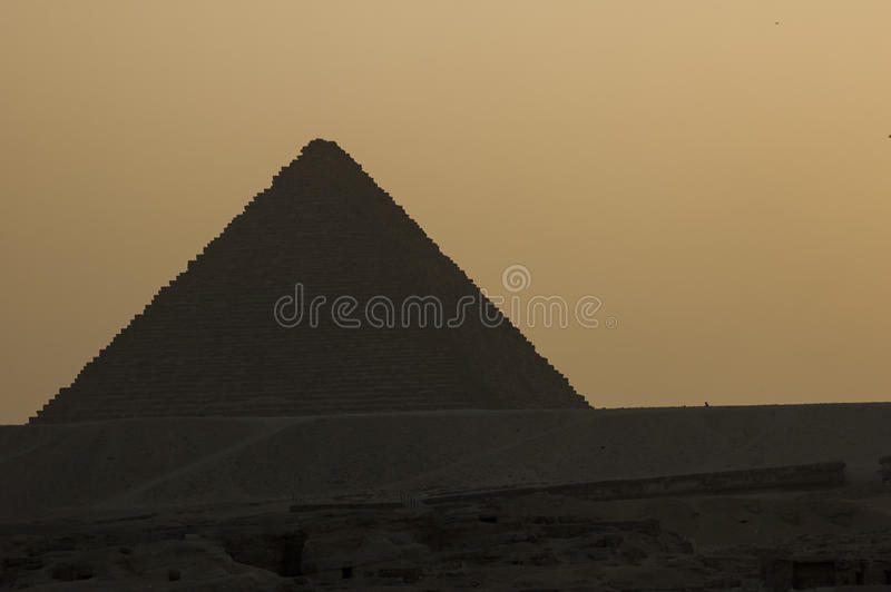 Pyramid of Chefren (backlit). Silhouette (sunset) of Great Pyramid of Giza, Egypt stock photography